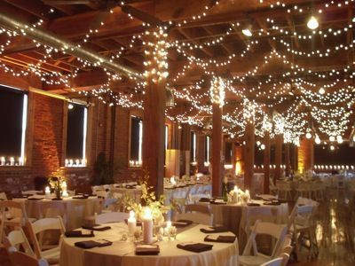 christmas lights on the ceiling are affordable and gorgeous for winter wedding decorations c