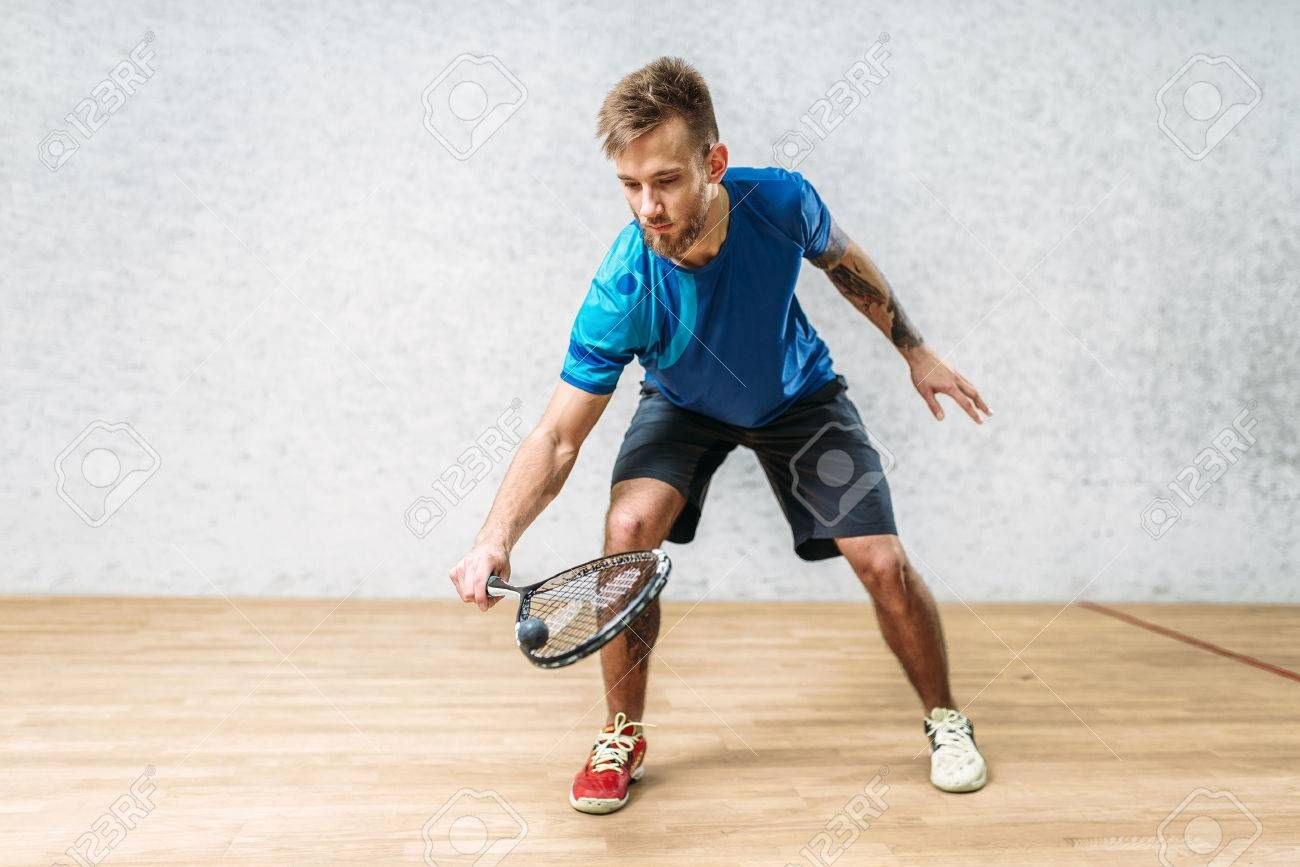 Squash game training, male player with racket ,
