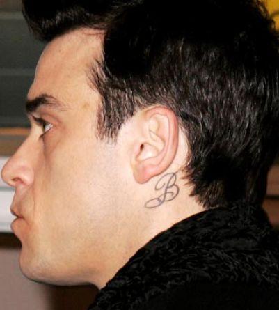 Robbie williams tattoo behind ear