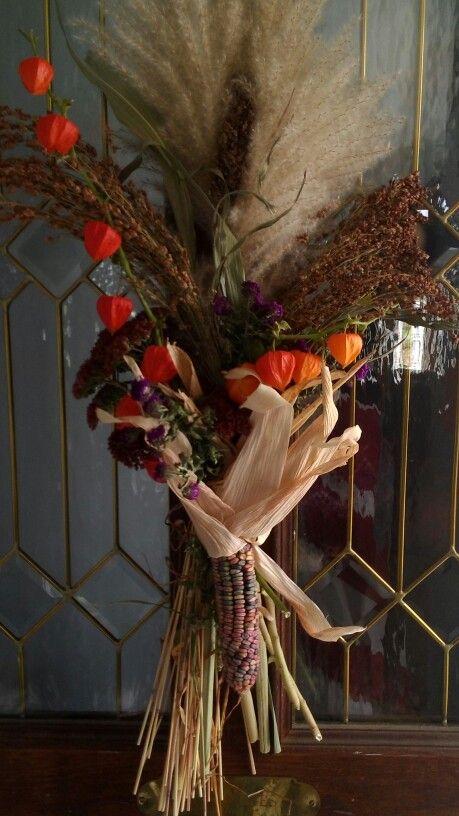 Front door decoration using chinese jack-o-lanterns, pampas grass, aster, broom corn, Indian corn.