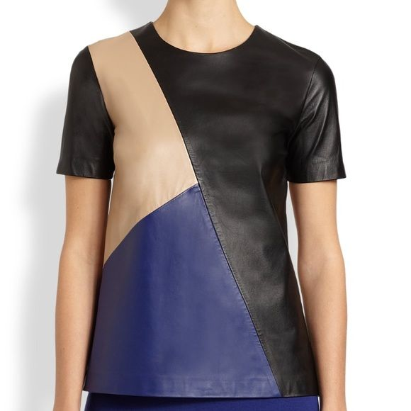 St. John Collection Napa Leather Colorblock Top This top is gorgeous! Buttery soft Napa leather throughout, light shoulder padding for structure, back zip. Perfect condition, no flaws whatsoever. Sold out everywhere! Originally $1395 at Saks. Feel free to make an offer! St. John Tops