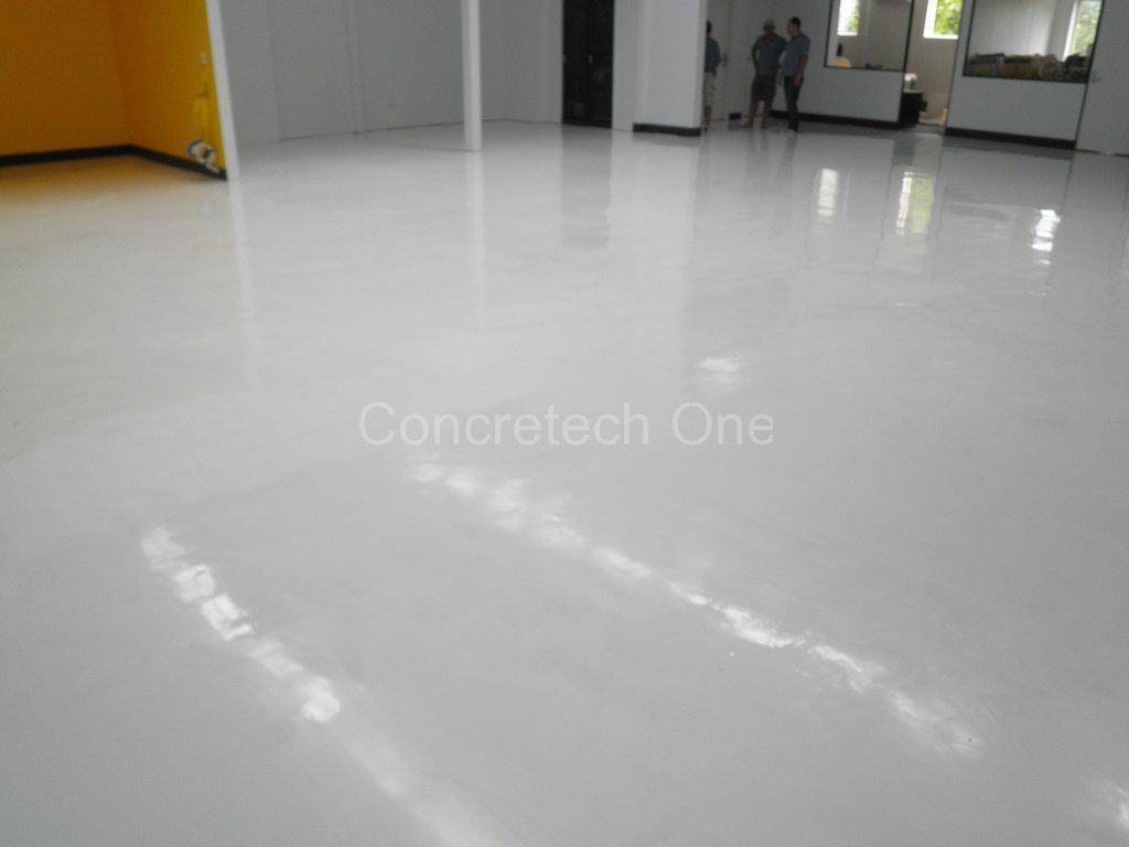 Clean white color polished concrete floors with grey wall for Mop on concrete floor wax