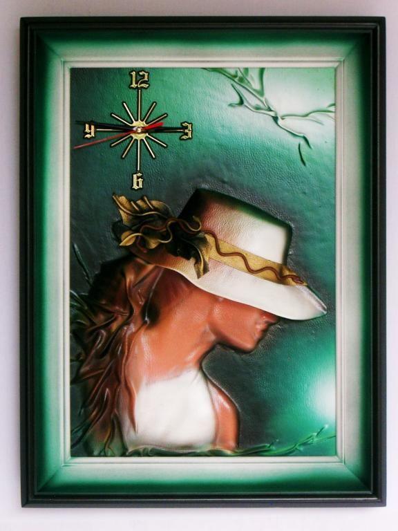 Obraz ze sk�ry,zegar �cienny p�yn�cy , na prezent.