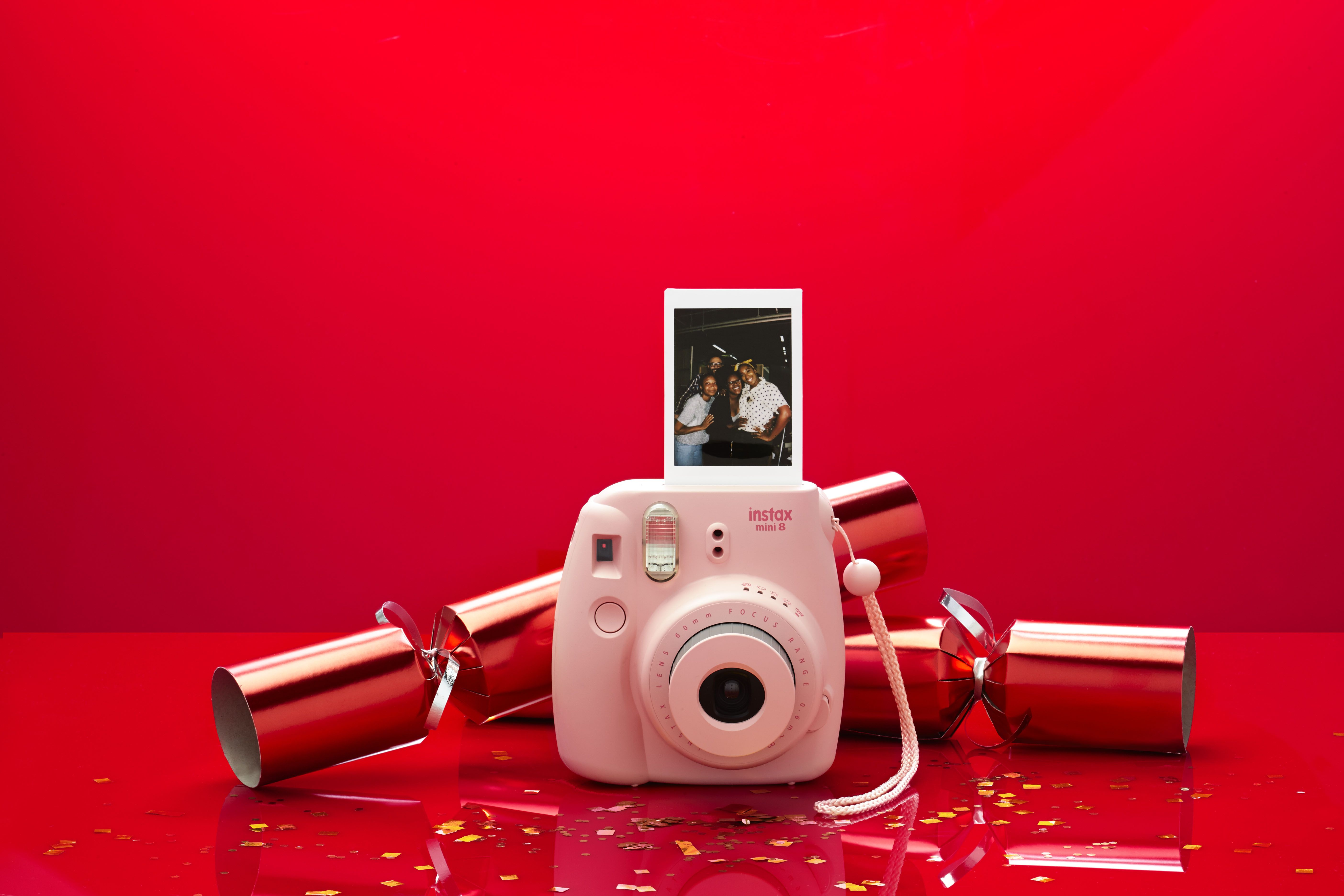 Instax Mini 8 Camera in pink perfect to capture the