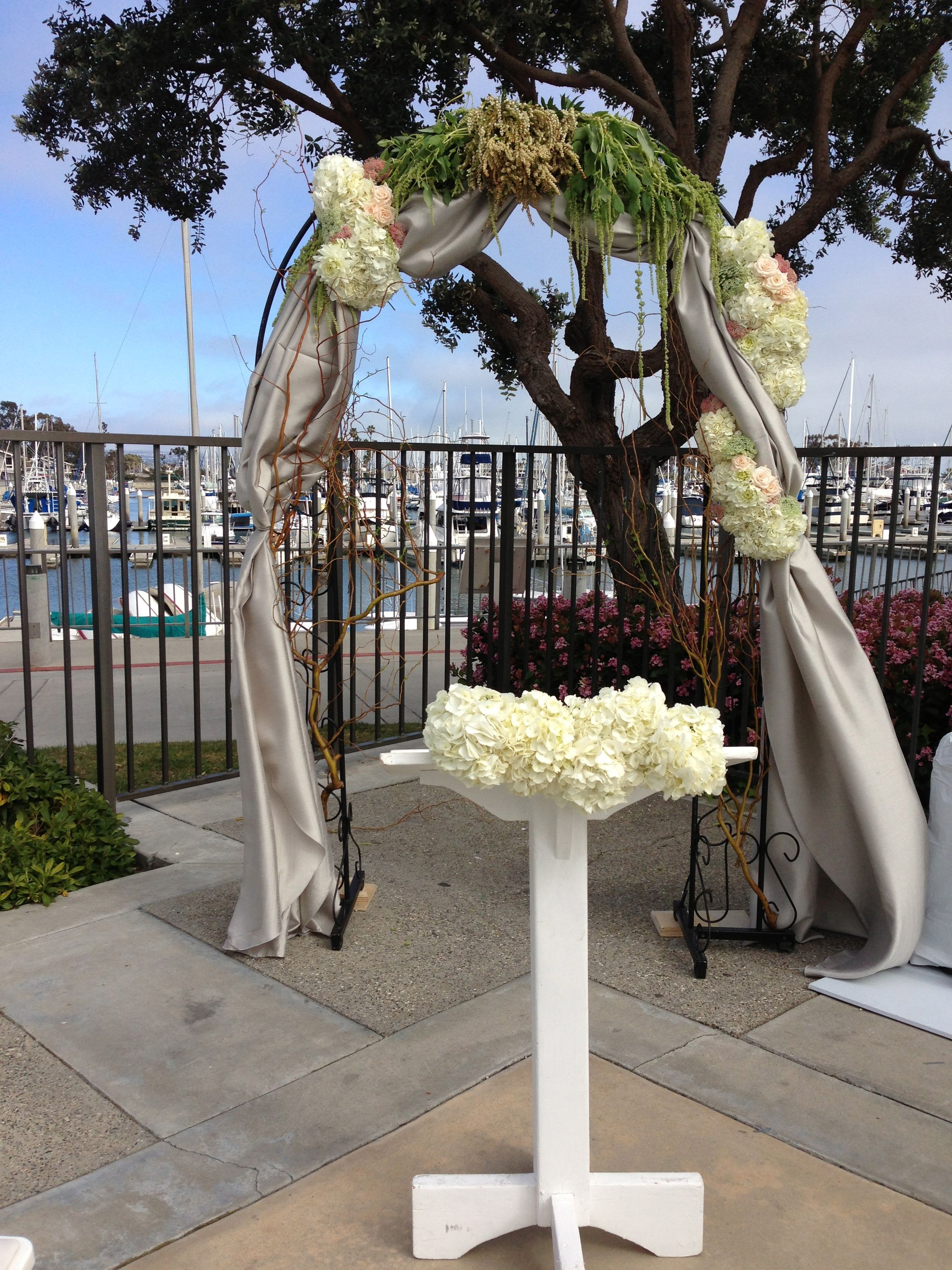 Rustic Wedding Arch Draped Fabric And Fresh Flowers White And Green With Curly Willow