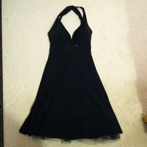 Women's sexy black dress Women's B. Darlin sexy black dress with slip and twill to give a little flare, with straps, polyester/spandex, knee length, preowned in good condition no holes or marks size 3/4 B. Darlin Dresses Backless
