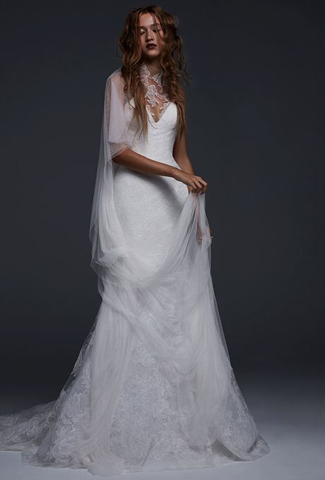 "Brides.com: . ""Favianna,"" Light ivory V-neck silk mermaid wedding dress with illusion high neck accented by hand placed Chantilly lace applique by Vera Wang"