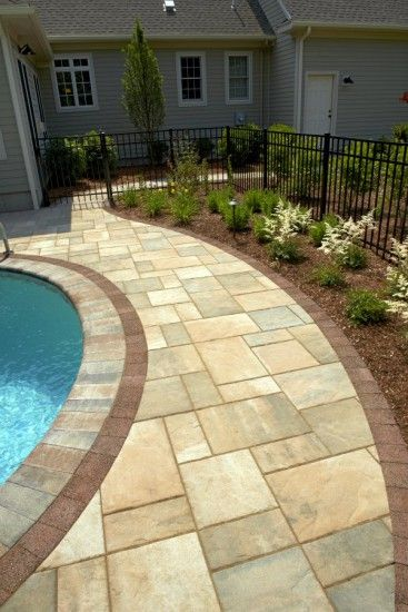 Pool with unilock beacon hill flagstone and series3000 Flagstone pavers around pool