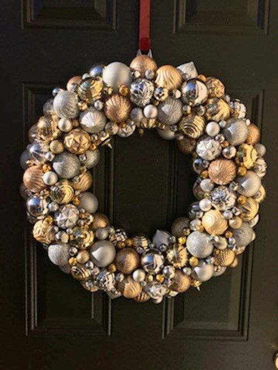 Gorgeous Silver and Gold Ornament Christmas Wreath! Bauble wreath! Holiday Wreath! Super detailed Or #baublewreath This wreath is where it all began!  I made a couple of wreaths for my family and friends for Christmas 2015.  Since we were in the process of buying a house and just picked up two beautiful baby Great Danes, I had my hands full! Wanted something unique, and next thing I knew I was staying up listening to old timey Christmas music and making wreaths until 4am! Come to find out, my li #baublewreath