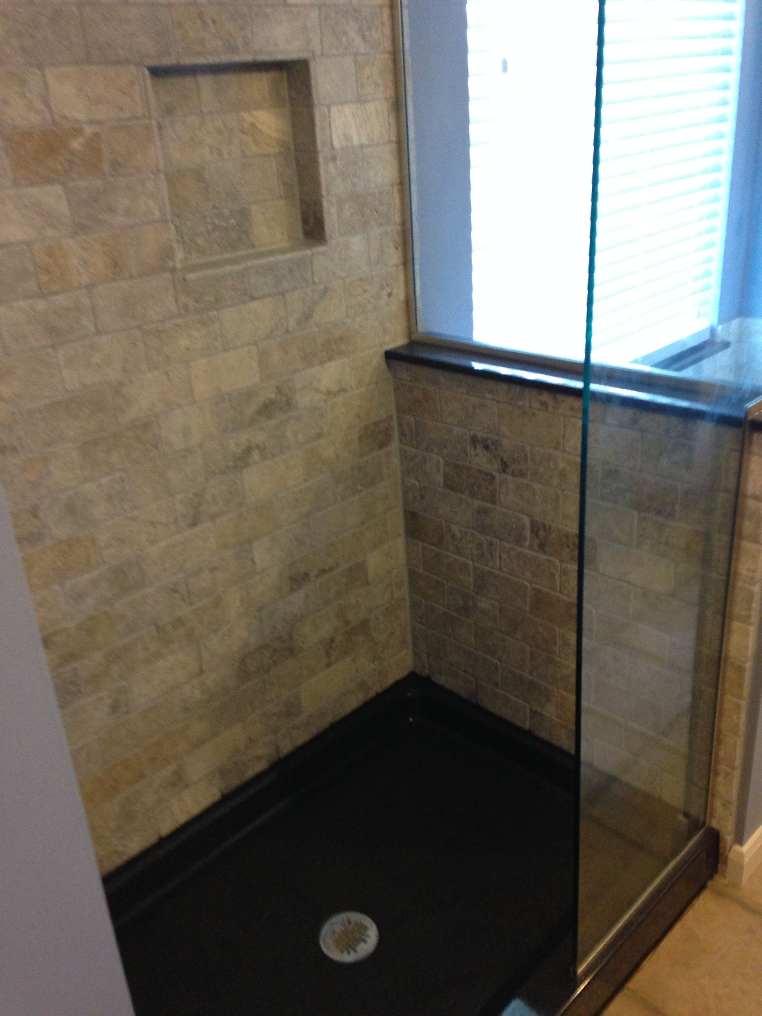 Travertine subway wall tile and shower niche. The Onyx ...