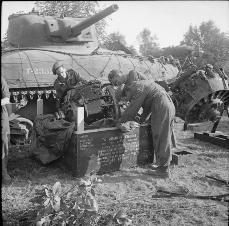 REME fitters prepare to install a new engine into a ...