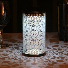 A bunch of these grouped together - Fretwork Solar Lanterns from Grandin Road