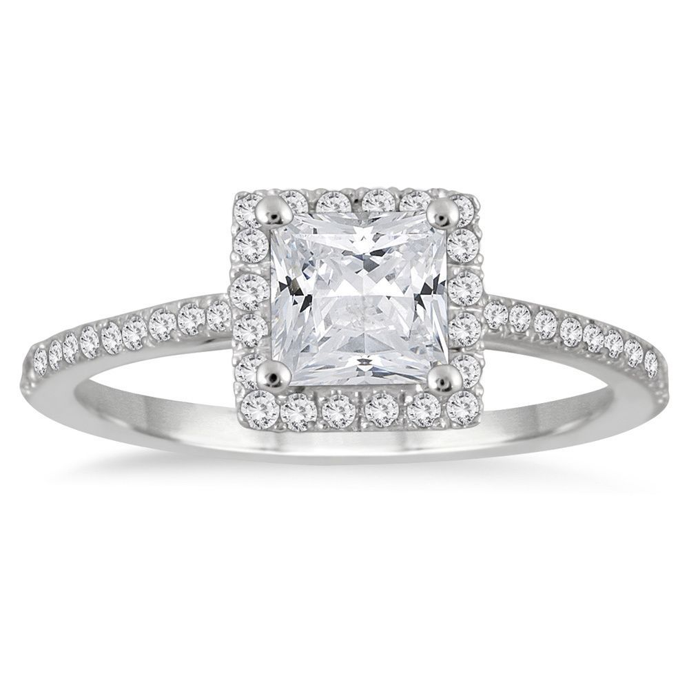 This vintage-inspired engagement ring is sure to stun with its princess-cut center diamond and squared halo. Mounted on 14k white gold with side stone accents, this ring shines with a highly polished finish.