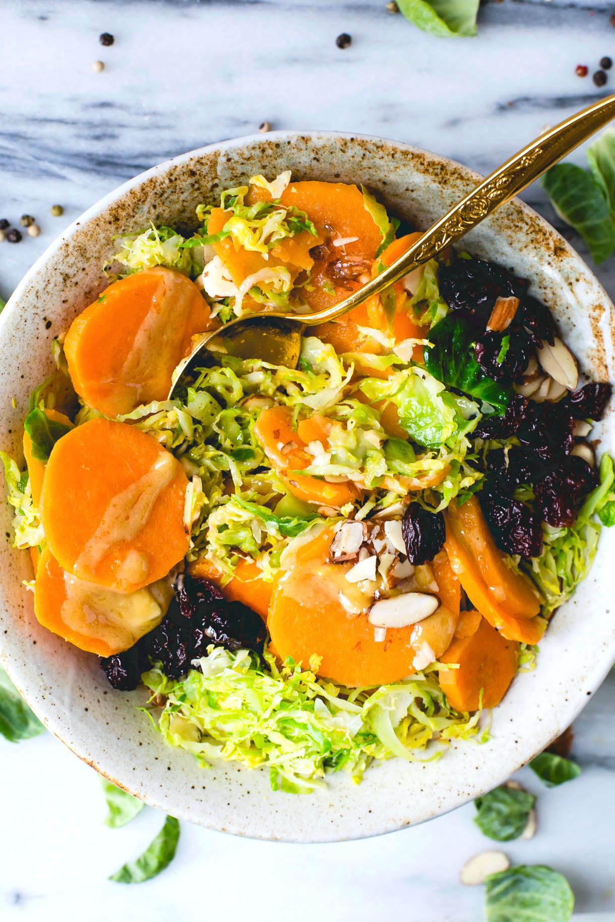 Glowing with paper-thin brussels sprouts, crunchy almonds and a maple mustard dressing, this colorful dish is the perfect answer for a winter craving.