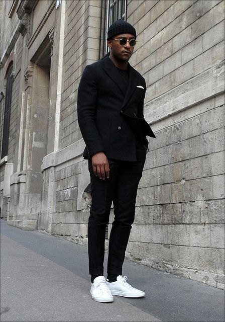 Black suit and white Common Projects