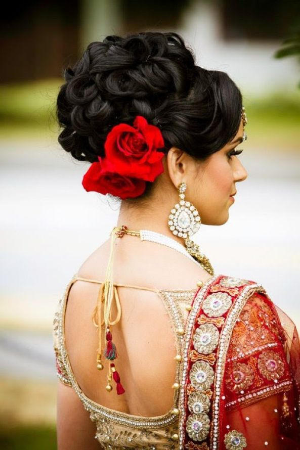 Indian Wedding Bridal Hairstyle With Roses Tucked In Underneath Indian Bridal Hairstyles Indian Wedding Hairstyles Wedding Hairstyles