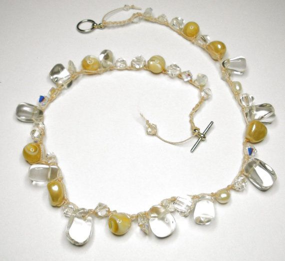 This delicate necklace is crocheted with mother or pearl, crystals and glass nugget beads. $26.00