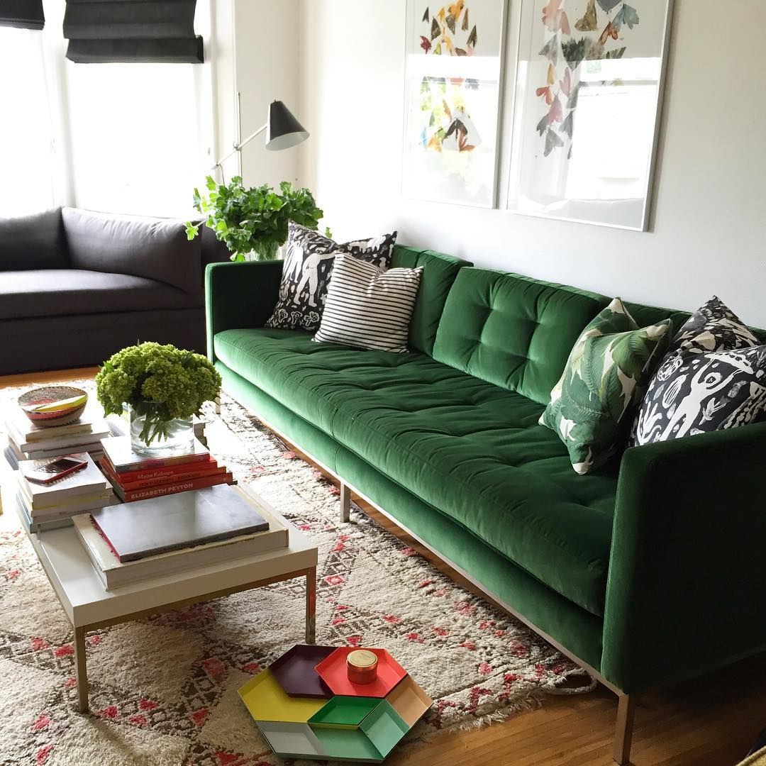 Making room for Christmas decor. Green sofa living room