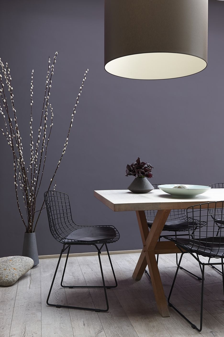 The black Bertoia Side Chairs are prefect in this dining room ...