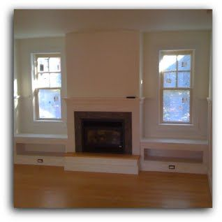 Living Room With Fireplace And Windows window seats flanking fireplace, contemporary, living room