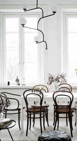 Learn how to create a calming environment in your home with this post from My Scandinavian Home. A simple color scheme and some stand-out light fixtures are all it took to create this minimalist dining room. Bright white walls and natural lighting help to open this space up and accentuate the gorgeous furniture pieces.
