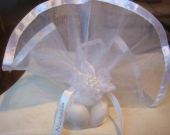The gift of a bomboniera is an Eastern Orthodox tradition, over 3,000 years old. Filled with koufeta (also known as jordan almonds) the favors are