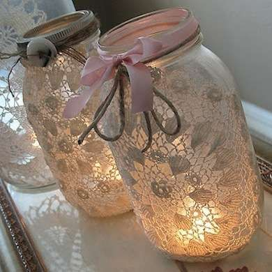 Spray fixative and lace dollies with twin and ribbon tied around neck of ball jars. Add sand and votive.