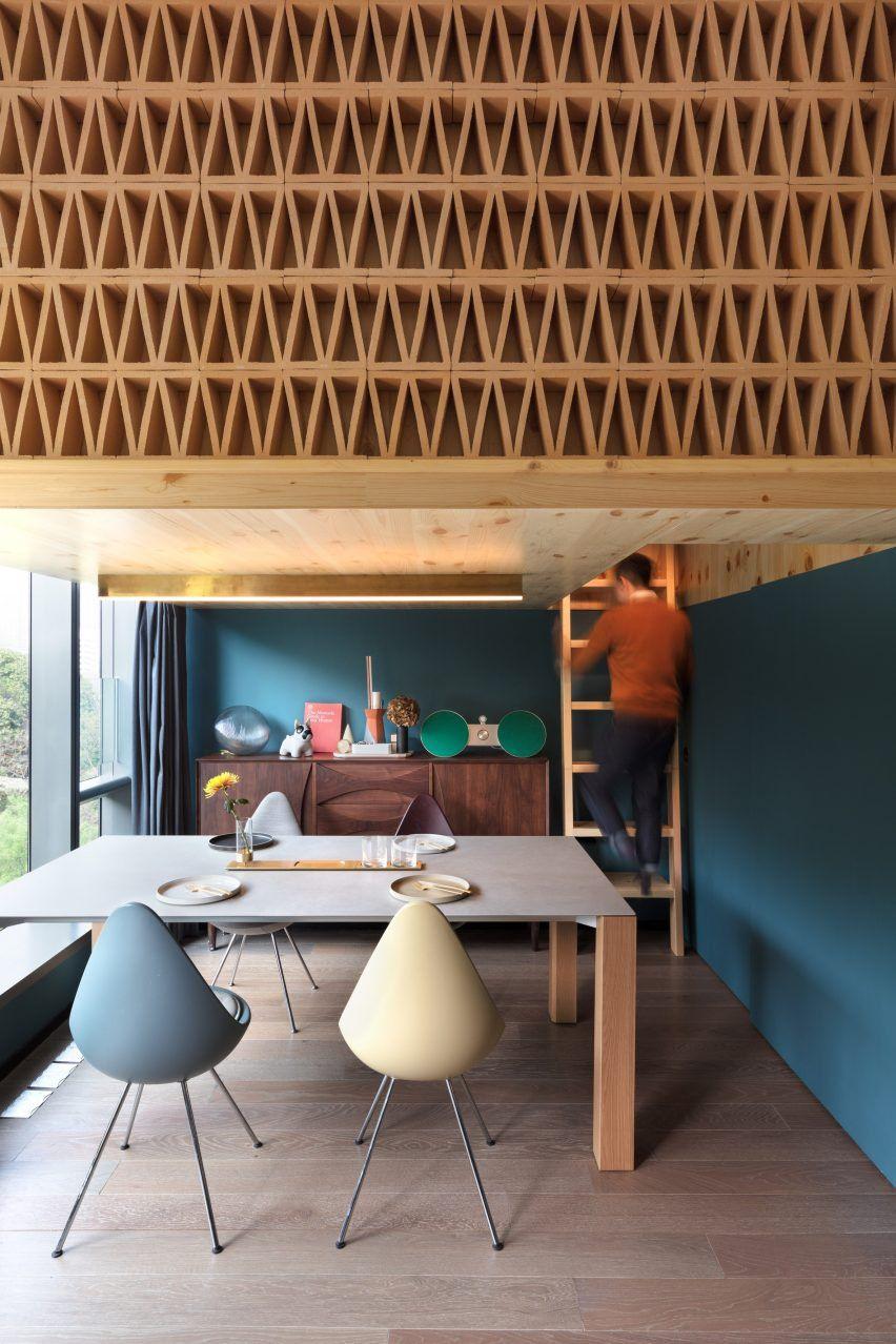 Ncda designs woodscreened loft bedroom for tiny hong kong treehouse