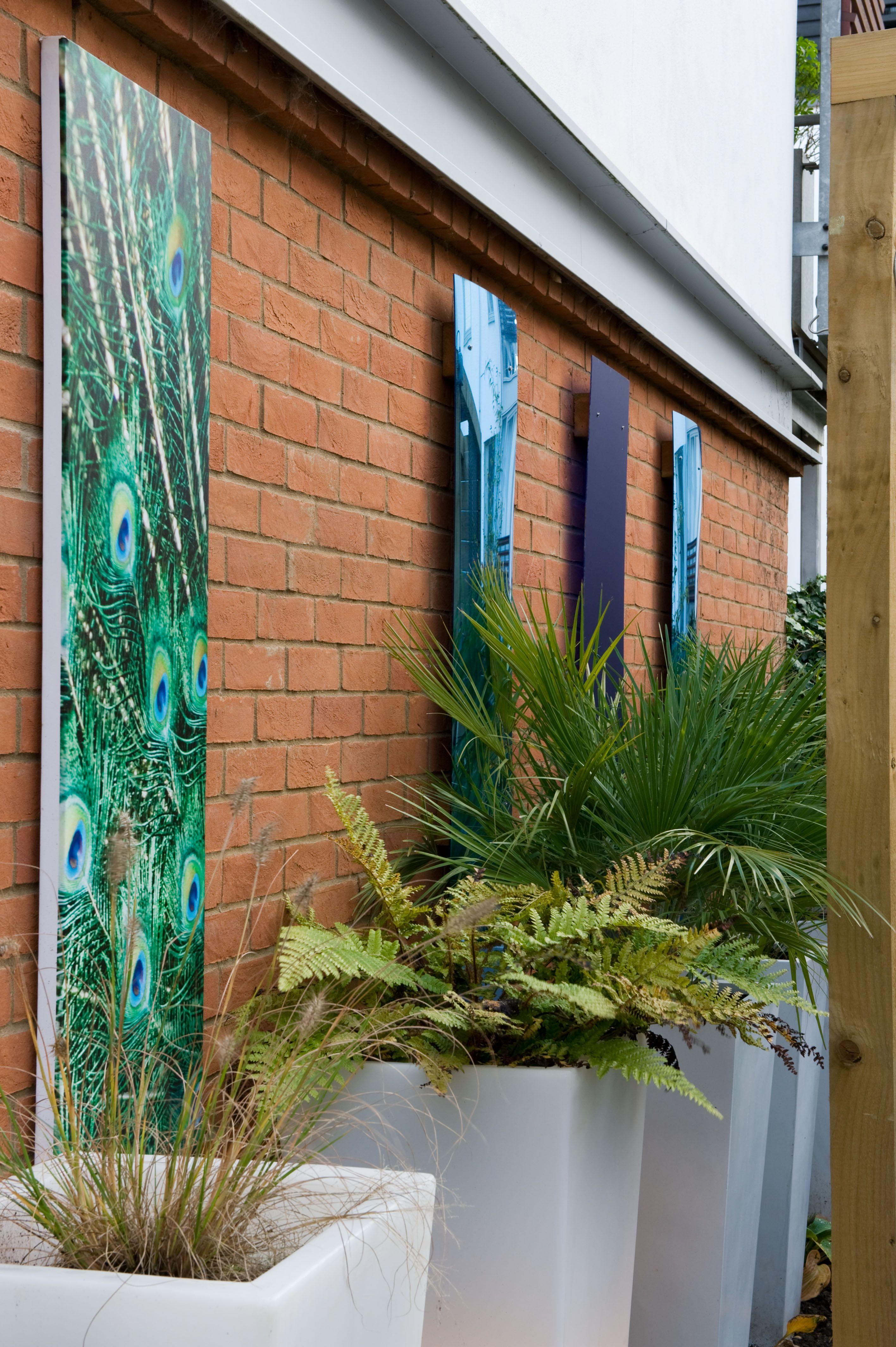 Modern garden wall art  Small modern garden design in Essex  Courtyard Garden Design in