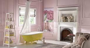 Pink and yellow bathroom... plush sofa ... yellow bath makes this bathroom pop