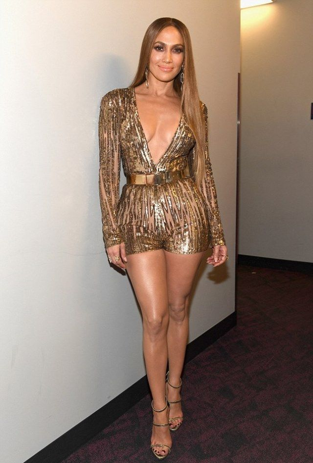 2e5840ac310 47 year-old Jennifer Lopez shined in 3 different outfits at the Latin  Grammys last night  one golden jumper with a deep V-cut neckline