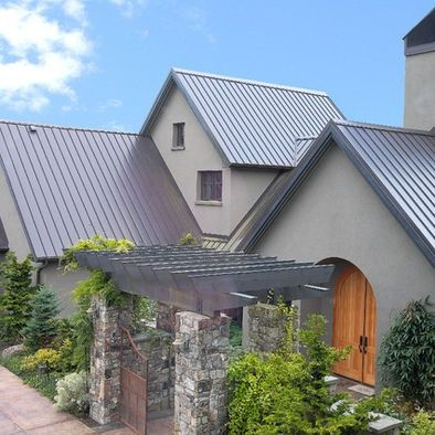 This Standing Seam Metal Roof Is An Englert Kynar Ultra Cool Low Gloss Metal Roof In A Dark Bronze Finish Stucco Homes Metal Roof Houses House Roof