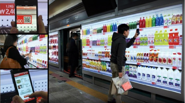 Tesco Virtual Subway Store - design meets mobile commerce.    Tesco (Homeplus in Korea) created a virtual store in the subway where commuters can buy their groceries out of a virtual wall.    Just scan the QR codes with your smartphones, products are added to your virtual cart and they get delivered to your home as soon as you are back.