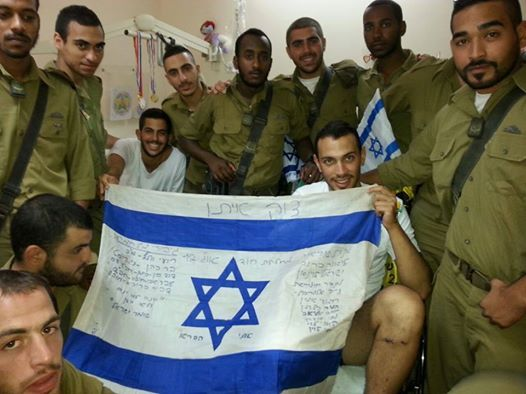 Golani soldiers in solidarity!  Proud Israelis!!! Golani Fighters defending  Israel home holding Israel flag  with  Nike Elgrabli July 2014