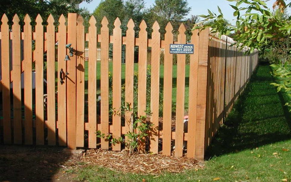 Example Of French Gothic Style Cedar Picket Fence With Topped Posts And Gate Wood Picket Fence Picket Fence Fence