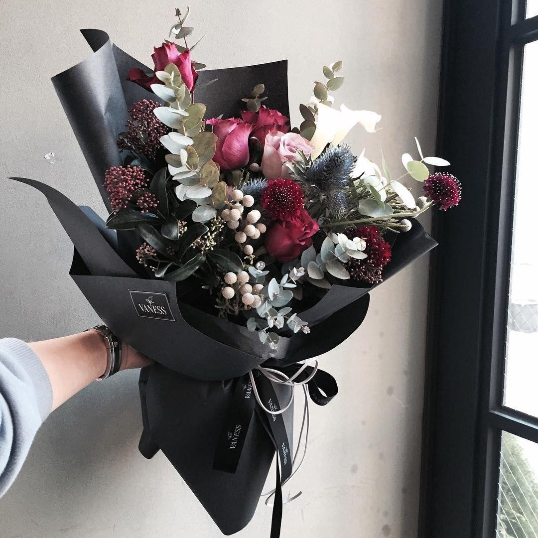 Reds, white, grey in black! Very striking! florist Lee Ju