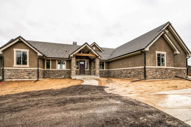 Ranch walk out design by copperleaf homes stone to stucco - Exterior paint coverage on stucco ...