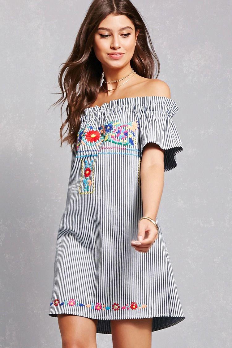10661016f9f8 A denim mini dress featuring a pinstripe pattern