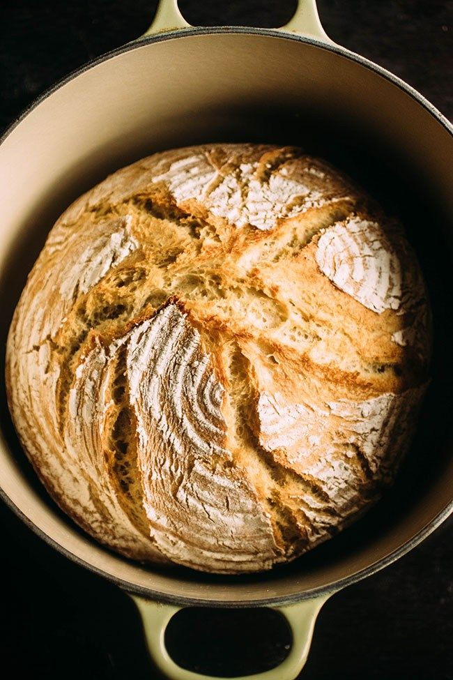Easy Crusty French Bread - This easy no knead dutch oven bread recipe is sure to be a hit! Ready quickly in just a few hours - no overnight rising necessary and no bread machine needed. Baked in a dutch oven for a crispy crust on the outside and soft, airy homemade bread on the inside! Will be one of your favorite quick bread recipes in no time! With a crispy crust and a soft exterior that will make it seem like artisan bread right from your home kitchen. Perfect right out of the oven, as sandwi