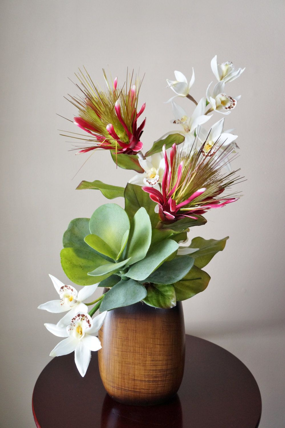 Silk flower arrangement tropical flower arrangement with orchids silk flower arrangement tropical flower arrangement with orchids and succulents set in faux wood ceramic vase home decor by brandybydesignltd on etsy mightylinksfo Gallery
