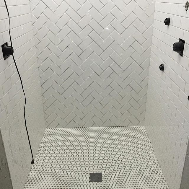 Classic Subway Tile With A Herringbone Design And Penny Rounds On The Floor  Of This Shower Part 90