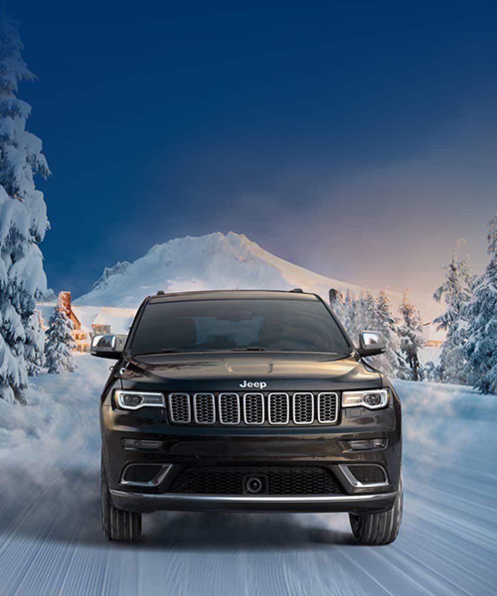 2019 Jeep Grand Cherokee Overview Hero Summit Black Winter Desktop