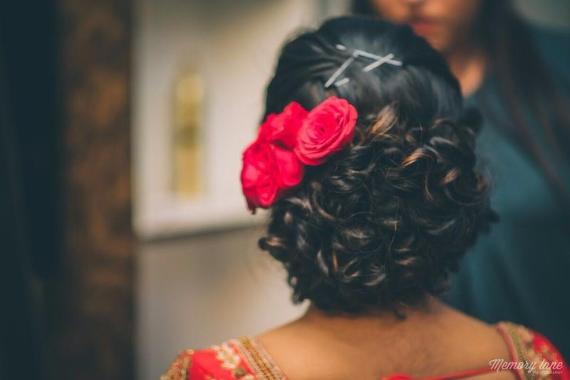 Curly Bridal Bun With Red Roses On Side Wedding Hairstyles
