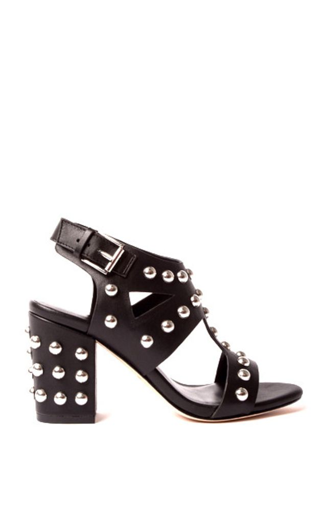 9229533cc60 Sleek gladiator style black leather sandals with a very walkable chunky block  heel and edgy studded