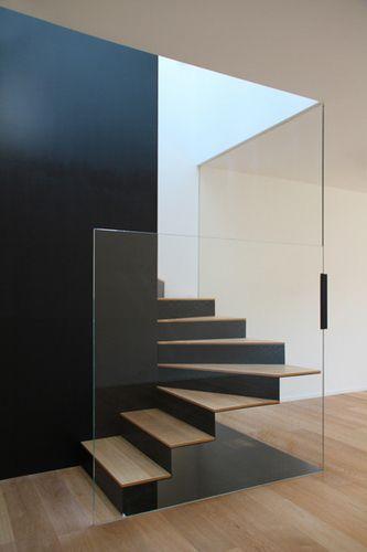 Black Wall with glass stairs. DEP Studio - CASA Red.  Modern Interior Design.  Contemporary Interior Architecture.