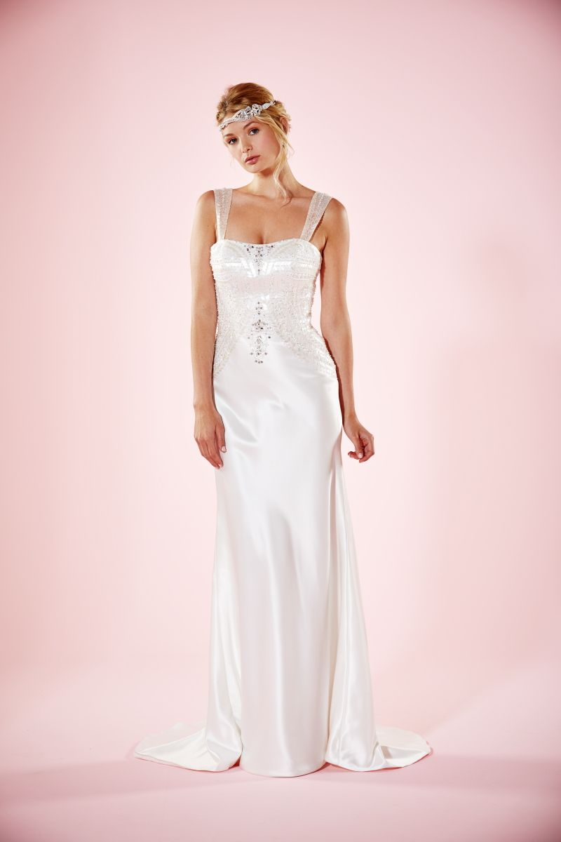 Harlow unleashes the great-Gatsby look for brides.  The beautiful silk beading on the bodice screams the 50's flapper girl look.  The beautiful silk hugs to the figure and leads out to a beautiful fish-tail | http://www.charlottebalbier.com/