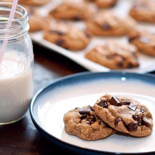 Joy of Vegan Baking peanut butter cookie recipe made with auqafaba and chocolate chips. Almond milk on the side #chocolatechipcookies #peanutbutter #vegancookies #vegan #aquafaba #veganbaking