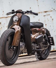 honda super cub motorcycle kitted up by K-speed and storm aeropart