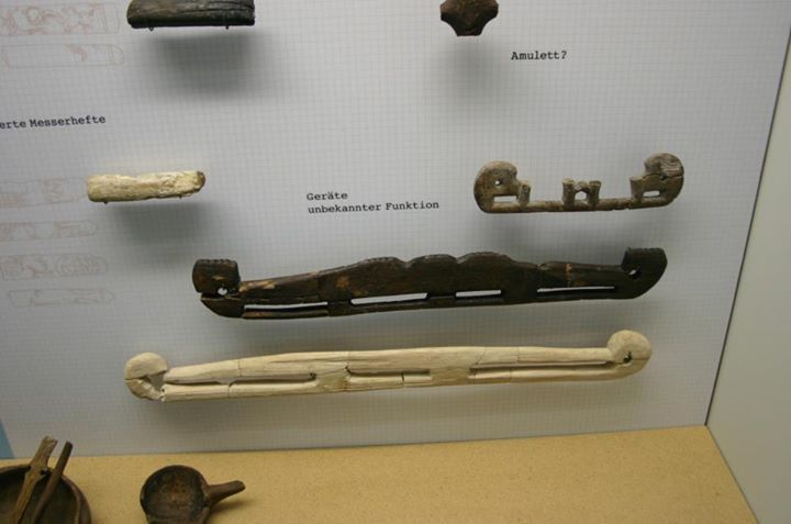 """Haithabu museum. Photo by Tom Nordulf. The wooden pieces on the bottom were labelled as bag handles in F. Westphal, """"Die Holzfunde von Haithabu"""", but note that the museum exhibit says they are """"objects of uknown function"""""""