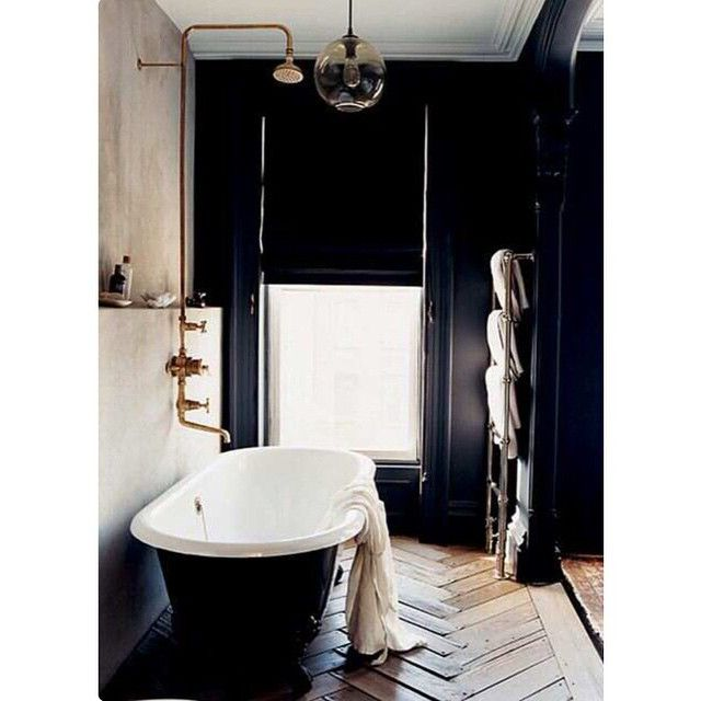 A dark, moody bathroom, via Pinterest. I just adore that Herringbone vintage floor. We have round glass lights in our Bisque Interiors range. See bio for website details x